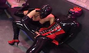 Strap-on lesbians in head to toe latex